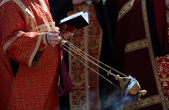 Censer in the hands of priest — Stock Photo