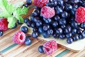 Bilberries and raspberries, summer fruit — Stock Photo