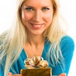 Girl with present box in hand — Stock Photo