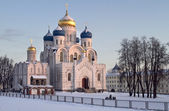 Evening winter landscape with church. — Stock Photo
