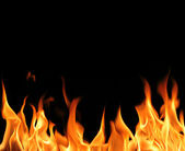 Fire flames on black background — Stock Photo