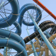 Stock Photo: Twisting, colorful water chutes
