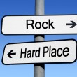 Foto Stock: Between rock and hard place.