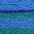 Knitted blue and green wool. - Stock Photo
