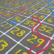 Stock Photo: Snakes and ladders numbers.