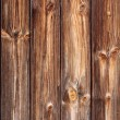 Dark brown panels in a wooden fence. — Stock Photo