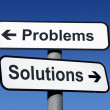 Signpost pointing to problems and solutions. - Stock Photo