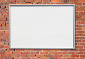 Billboard sign on an old red brick wall. — Stock Photo