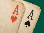 2 old dirty aces poker cards. — Stock Photo