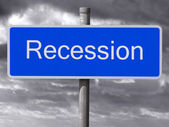 Recession sign and a dark cloudy sky. — Stock Photo