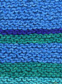 Knitted blue and green wool. — Stock Photo