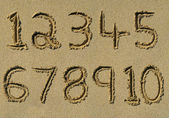 Numbers one to ten written in sand. — Stock Photo