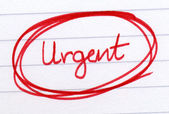 Urgent circled in red ink. — Stock Photo