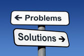 Signpost pointing to problems and solutions. — Photo