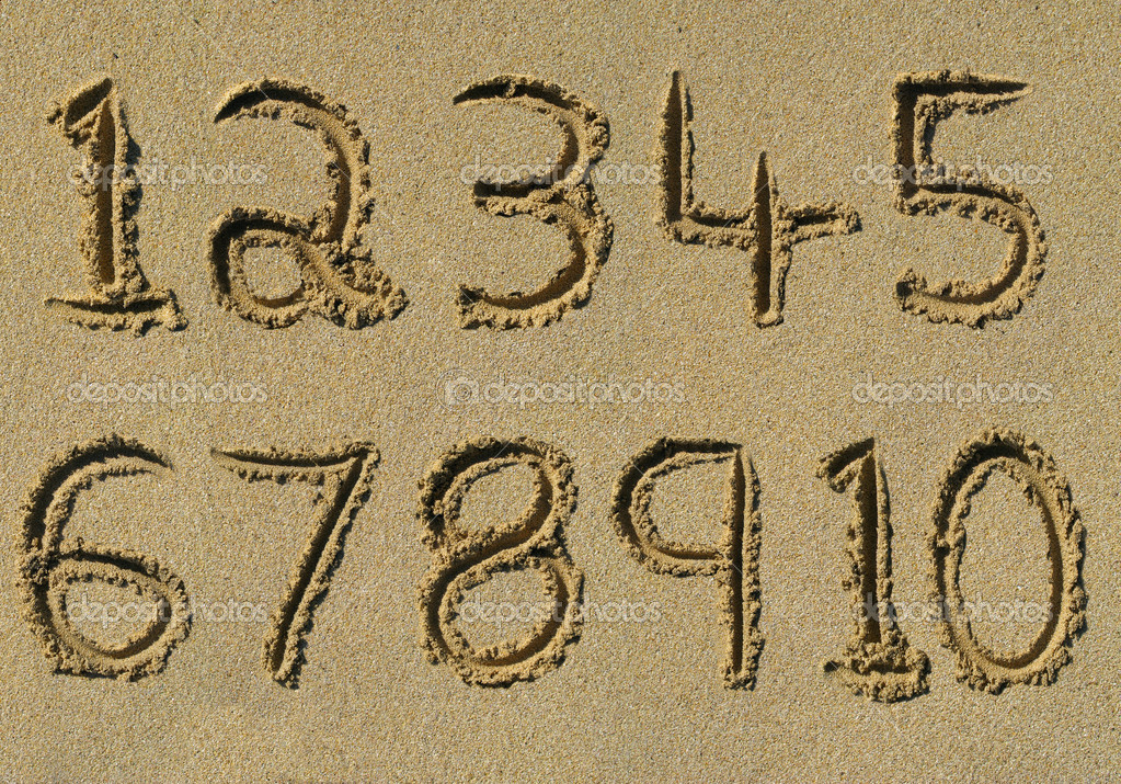 Numbers one to ten written on a sandy beach. — Stock Photo #1888026