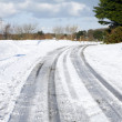 Snow tracks on a country road. — Stock Photo