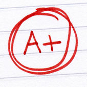 A+ grade written on a test paper. — Stock Photo