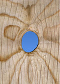 A peep hole in a wooden fence. — Stock Photo