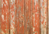 Orange flaky paint on a wooden fence. — Foto de Stock