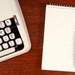 Typewriter and notepad. — Stock Photo
