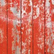 Red flaky paint on a wooden fence. — Foto de Stock