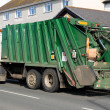 Green rubbish truck. — Stock Photo