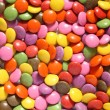 Lots of colorful smarties. — Stock Photo