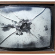 Stock Photo: Old trashed TV with smashed screen.