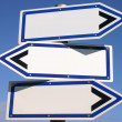 Blank three-way direction sign. — Stock Photo