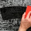 Cleaning a blackboard with a duster. — Stock Photo