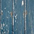 Blue flaky paint on a wooden fence. — Lizenzfreies Foto