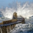 Big wave splash on Portreath pier. - Stock Photo