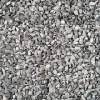 Lots of large gray stone chippings. - Stock Photo
