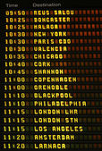 Airport airplane departures board. — Stock Photo