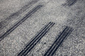 A close up of skid marks on a road. — Stock Photo