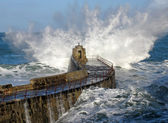 Big wave splash on Portreath pier. — Stock Photo
