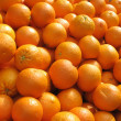 Lots of fresh oranges fruit close up. — Stock Photo #2509061