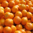 Lots of fresh oranges fruit close up. — Foto de Stock   #2509061