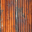 Rusty old corrugated fence. - Stock Photo