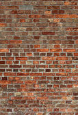 Dirty old red brick wall close up. — Stock Photo