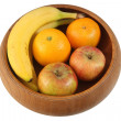Fruit in wooden bowl isolated. — Stock Photo