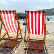 Stock Photo: Two empty deckchairs.
