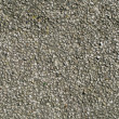 Old tarmac road stones texture. — Stock Photo