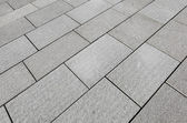 Large grey paving slabs close up. — Stock Photo