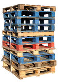 Stack of wooden pallets isolated. — Stock Photo