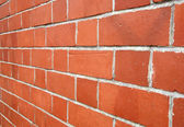 Looking along a red brick wall. — Stock Photo