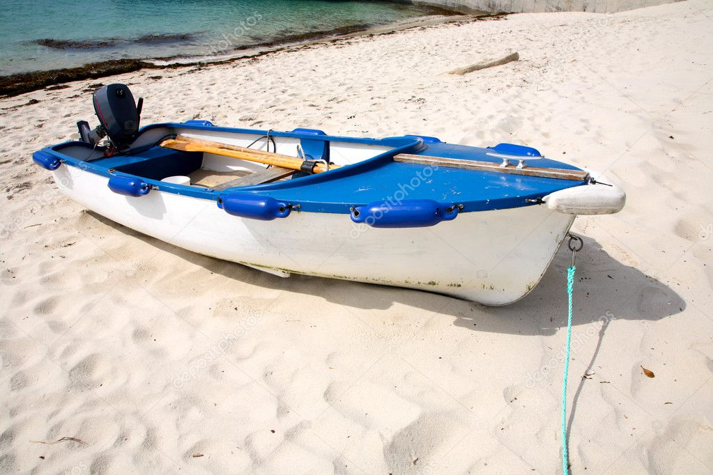 A white motorboat pulled up on the beach.  Stock Photo #2613806