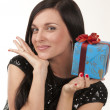 The beautiful girl with a present — Stock Photo #1140387