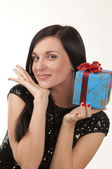 The beautiful girl with a present — Stock Photo