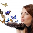 Woman with flying butterflies. - Stock Photo